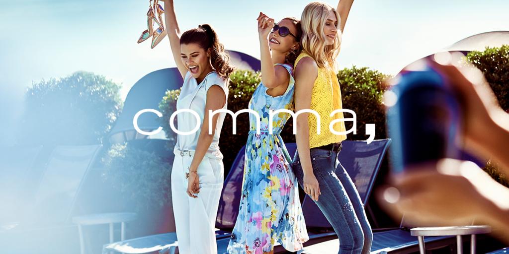 tanzende frauen zeigen das comma-lebensgefuehl.